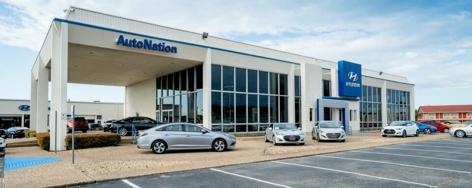 Exterior shot during the day of AutoNation Hyundai North Richland Hills, an auto dealership where cars and SUVs are sold.