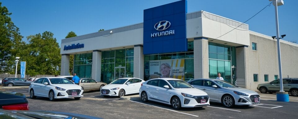 Exterior shot during the day of AutoNation Hyundai O'Hare, an auto dealership where cars and SUVs are sold.