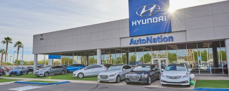 Exterior shot during the day of AutoNation Hyundai Tempe, an auto dealership where cars and SUVs are sold.