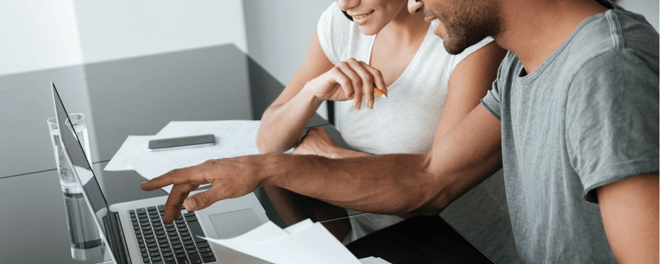 Young couple applying for an auto loan online