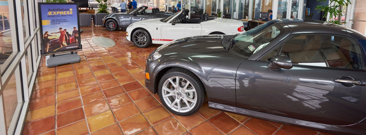 AutoNation Corpus Christi Showroom with three Mazda Miatas