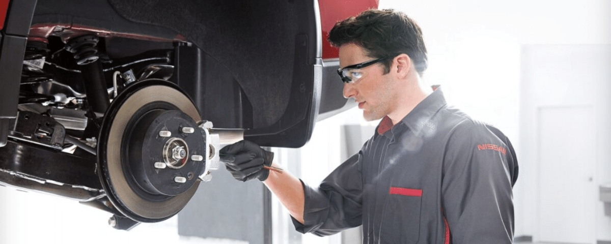 Nissan technician performing brake service