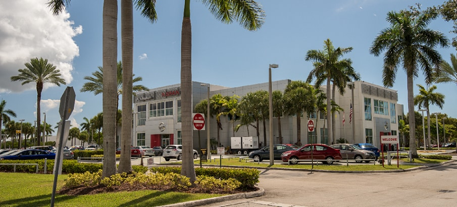 Exterior entrance to AutoNation Nissan Kendall dealer during the day