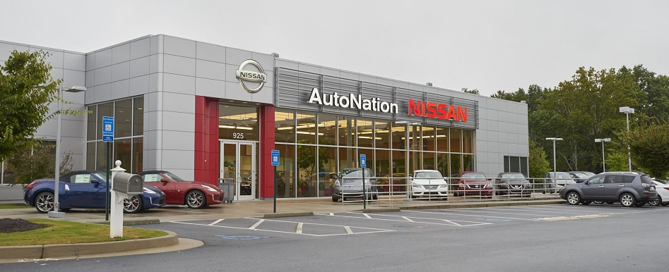 Exterior entrance to AutoNation Nissan Marietta dealer during the day