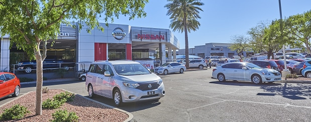 Exterior entrance to AutoNation Nissan Tempe dealer during the day