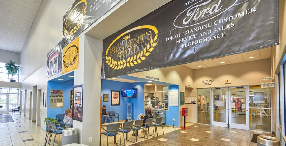 Interior view of AutoNation Ford North Canton with awards banners