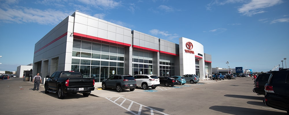 Exterior view of AutoNation Toyota Corpus Christi during the day