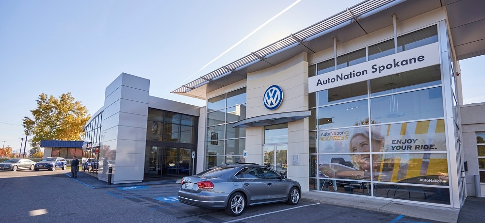 Exterior entrance to AutoNation Volkswagen Spokane dealer during the day