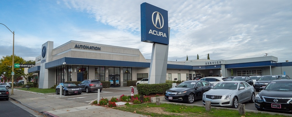 Exterior entrance to AutoNation Acura Stevens Creek dealer during the day