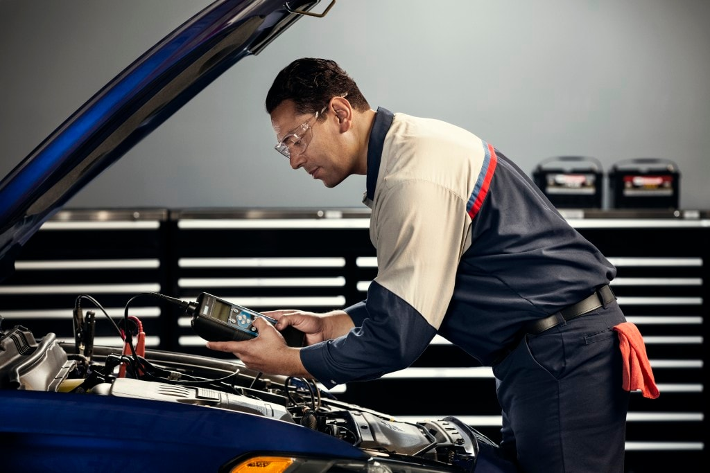 Ford Service Technician Performs a  Battery Check