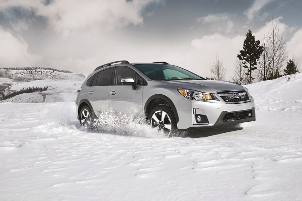 Subaru Crosstrek SUV driving in snow