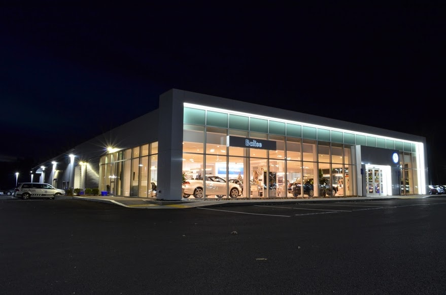 Balise Volkswagen dealership at night