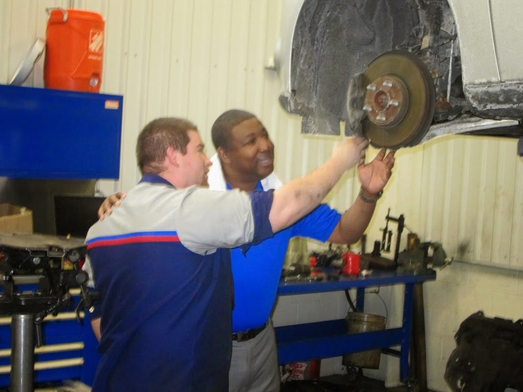 the service staff at Balise Ford look  at a repair