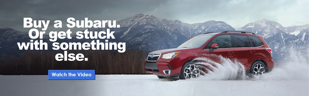Red Subaru Forester in snow