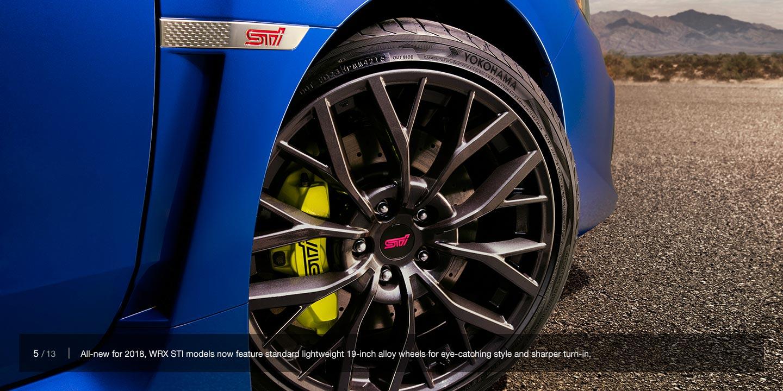 yellow brembo brake calipers on 2018 subaru sti