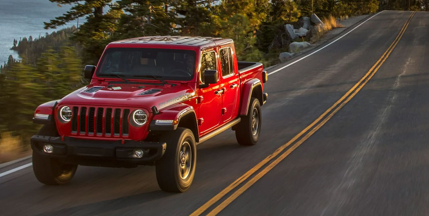 2021 Jeep Gladiator driving down the road