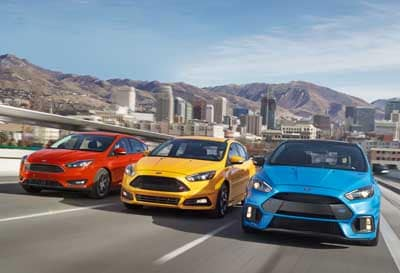 red, yellow, blue ford focus cars