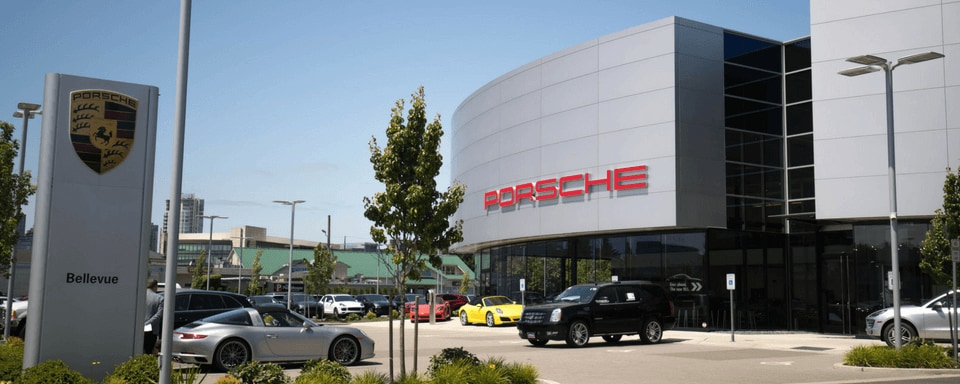 Exterior entrance to Porsche Bellevue dealer during the day
