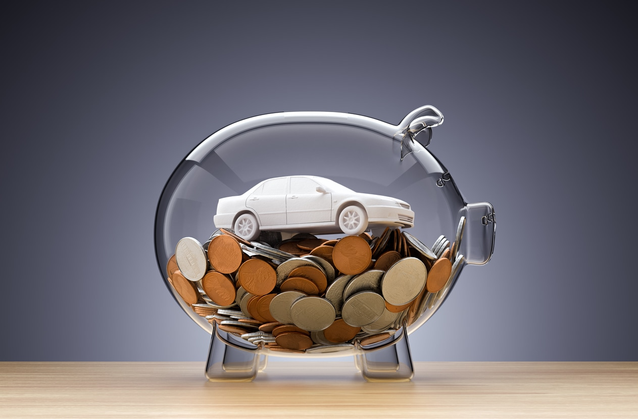 Clear Piggy Bank with Change and Car Model Inside