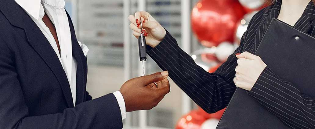 Auto Professional Handing Car Keys to Client