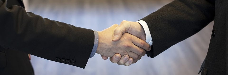 Confident leaders shaking hands