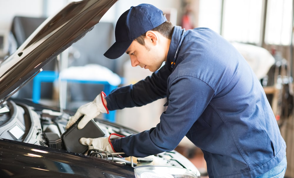 Certified technician performing maintenance at our Chevrolet and BMW service center in Lafayette