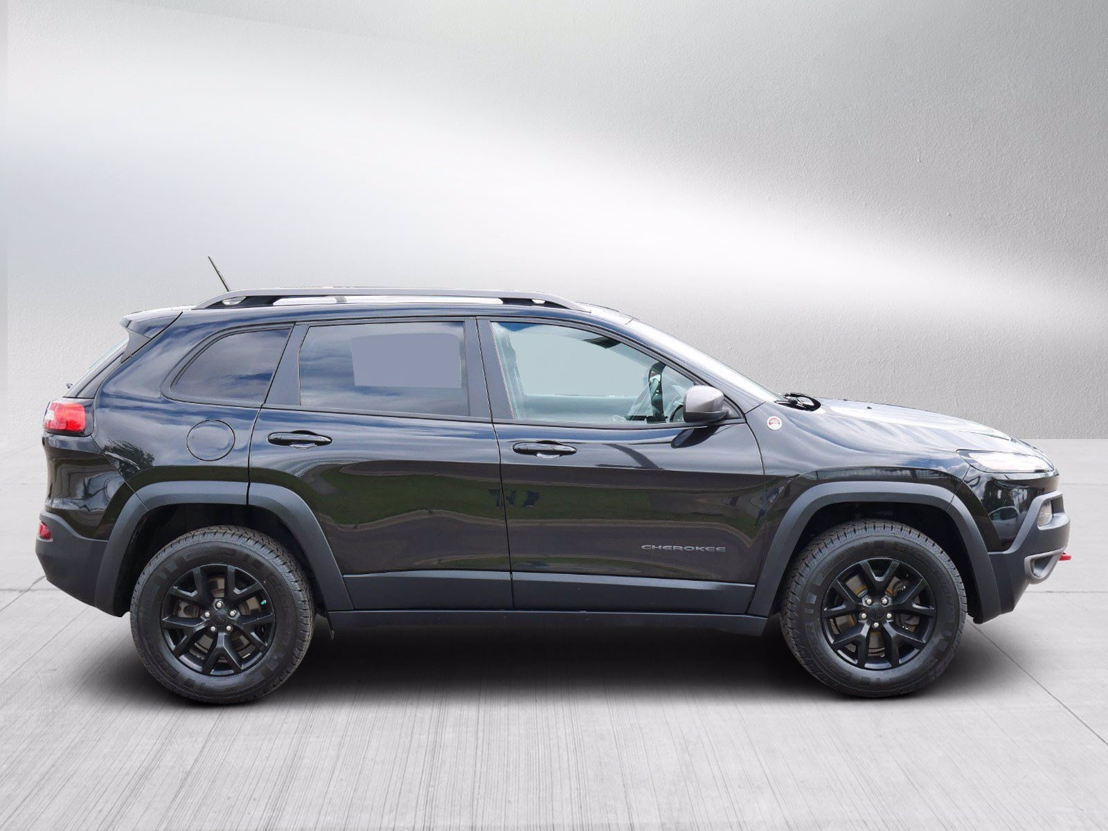 Used 2015 Jeep Cherokee Trailhawk with VIN 1C4PJMBS7FW705191 for sale in Bloomington, Minnesota