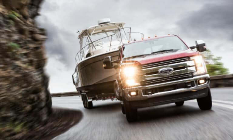2019 Ford Super Duty towing boat along cliff