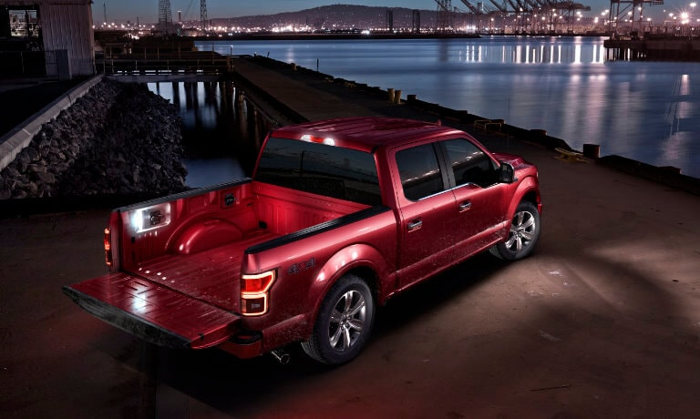2019 Ford F-150 Exterior night at pier with tailgate down and lit empty bed