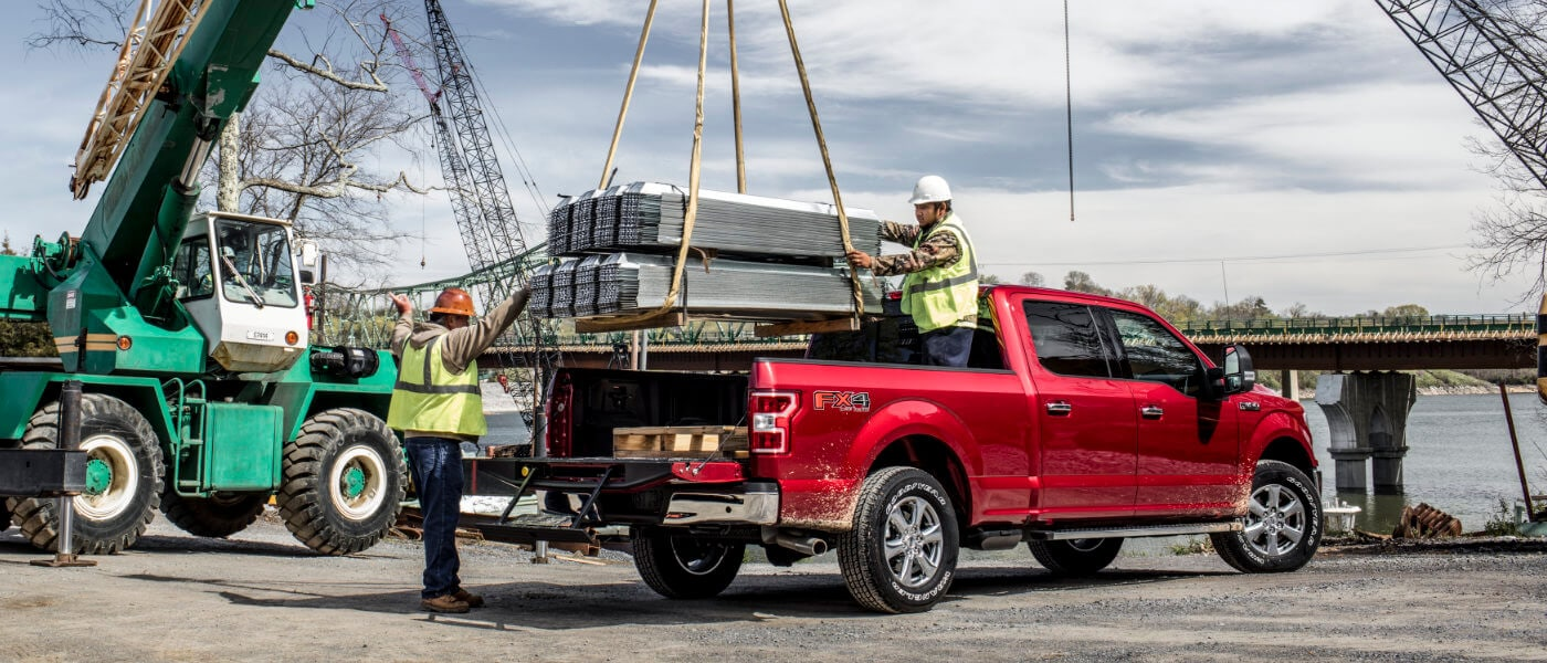 2019 Ford F-150 at construction site with heavy payload on crane