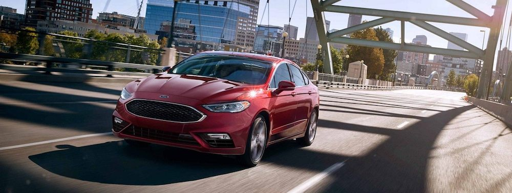 2019 Red Ford Fusion Driving Over A Bridge