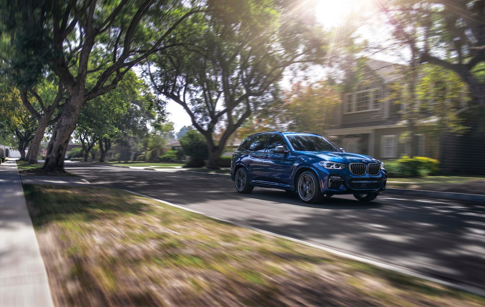 Shop from Home at BMW of Bel Air | 2020 BMW X3 driving through suburb