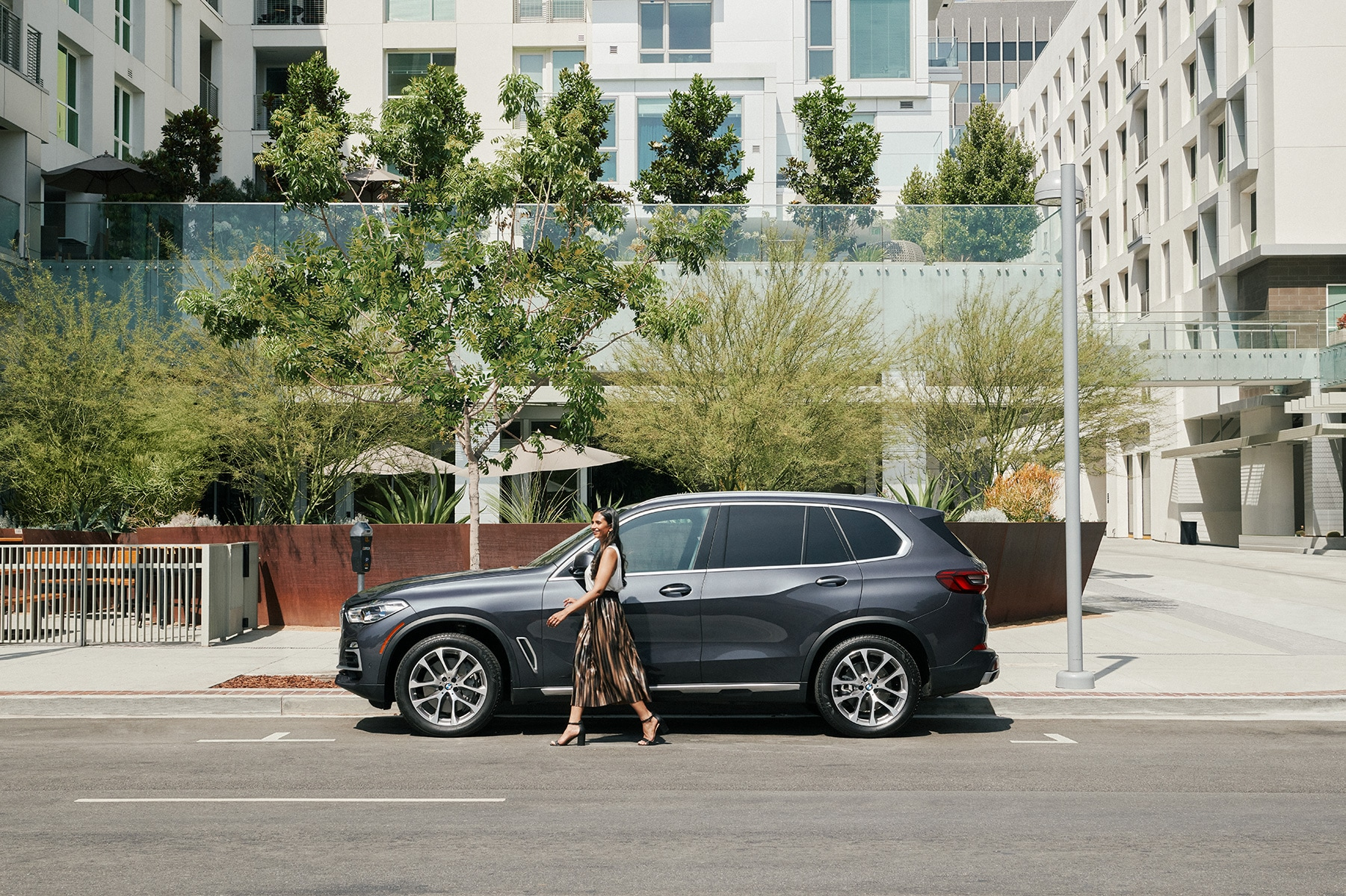 Shop from Home at BMW of Bel Air | 2021 BMW X5 parked outside of city building
