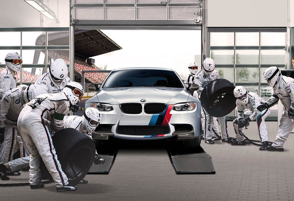 BMW motorsport technicians performing service