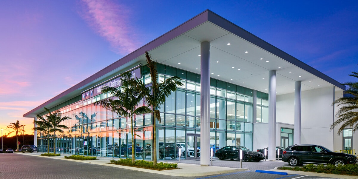 Exterior view of BMW of Delray Beach  in the evening