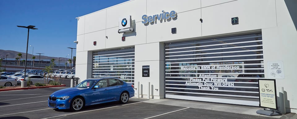 Exterior view of service center entrance at BMW of Henderson