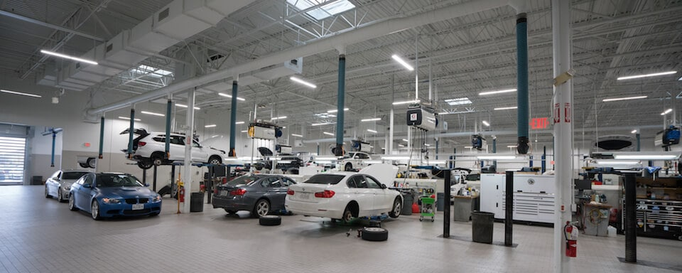 Interior view of service bays at BMW of Houston North
