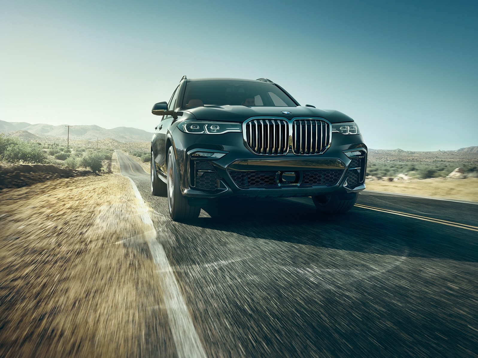 Model Features of the 2020 BMW X7 at BMW of Rockville | Black 2020 BMW X7 running on road