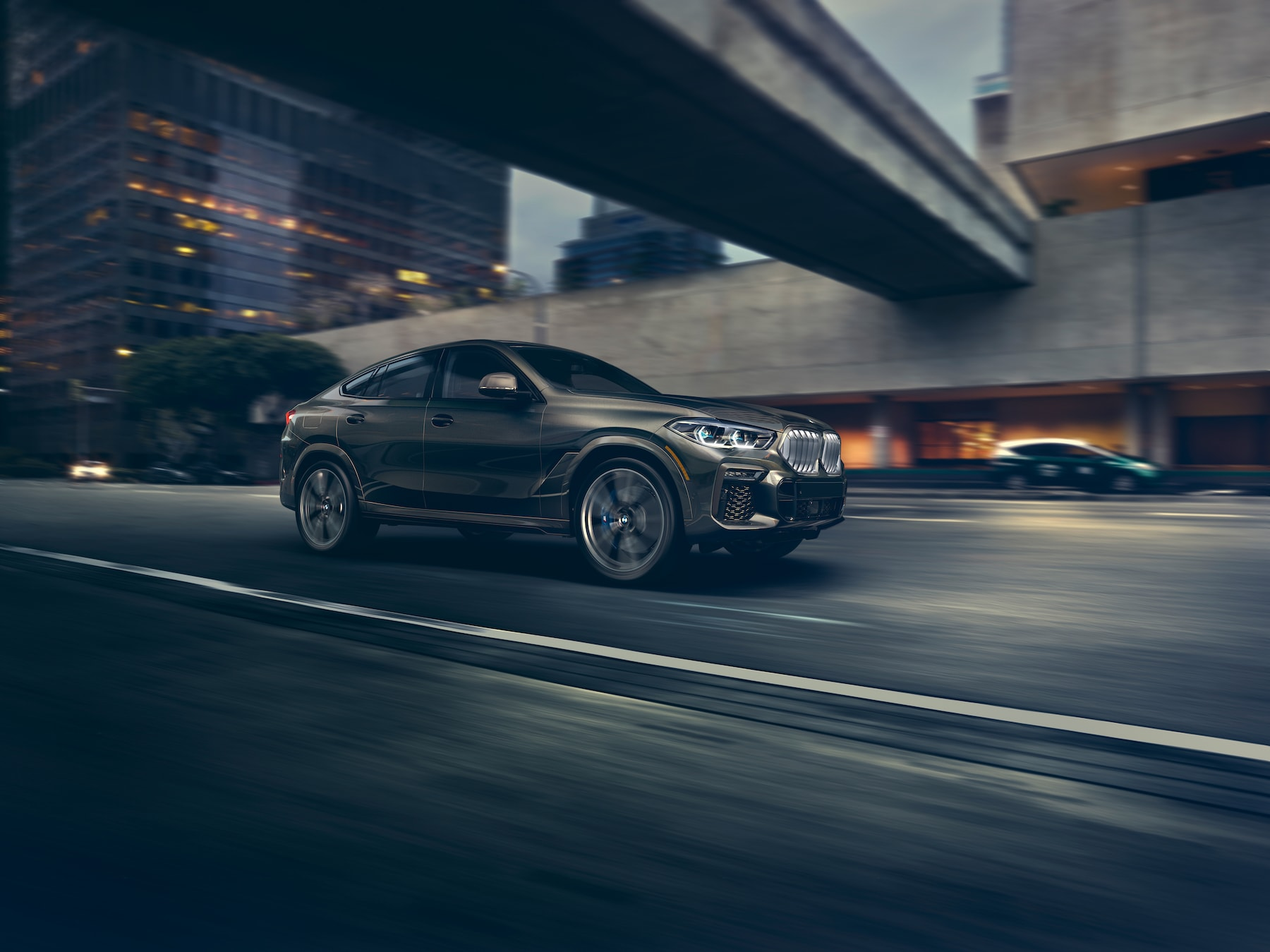 Model features of the 2020 X7 at BMW of Rockville | Grey 2020 BMW X6 running on road