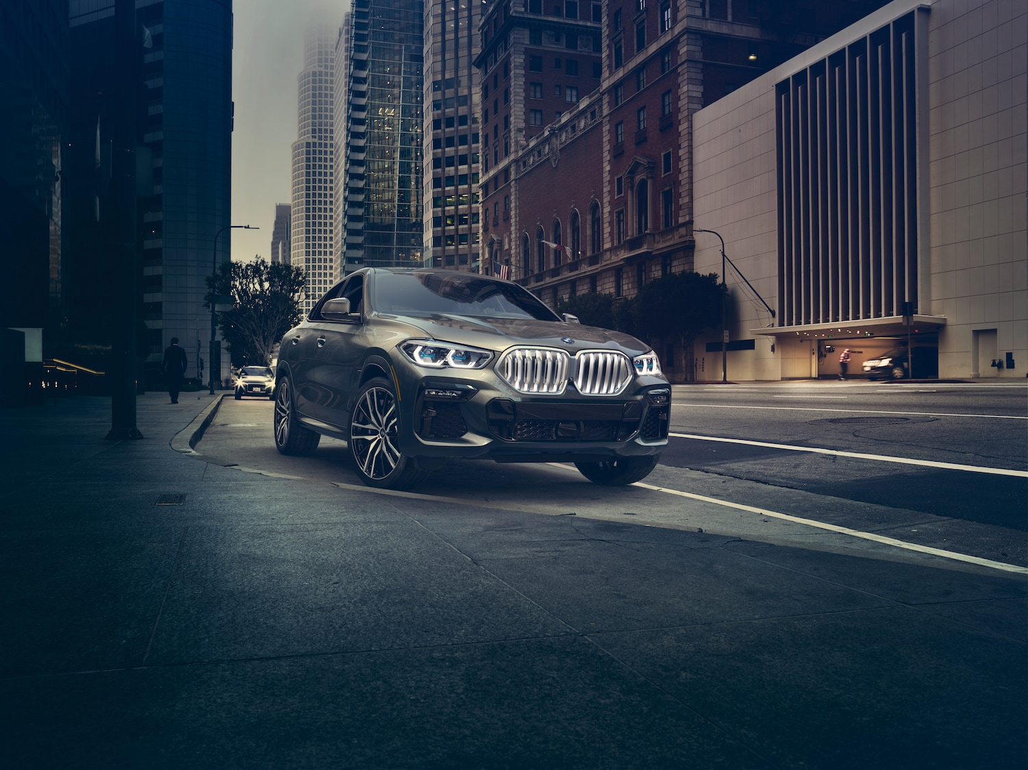 Model features of the 2020 X7 at BMW of Rockville | Grey 2020 BMW X6 parked on the side of the street