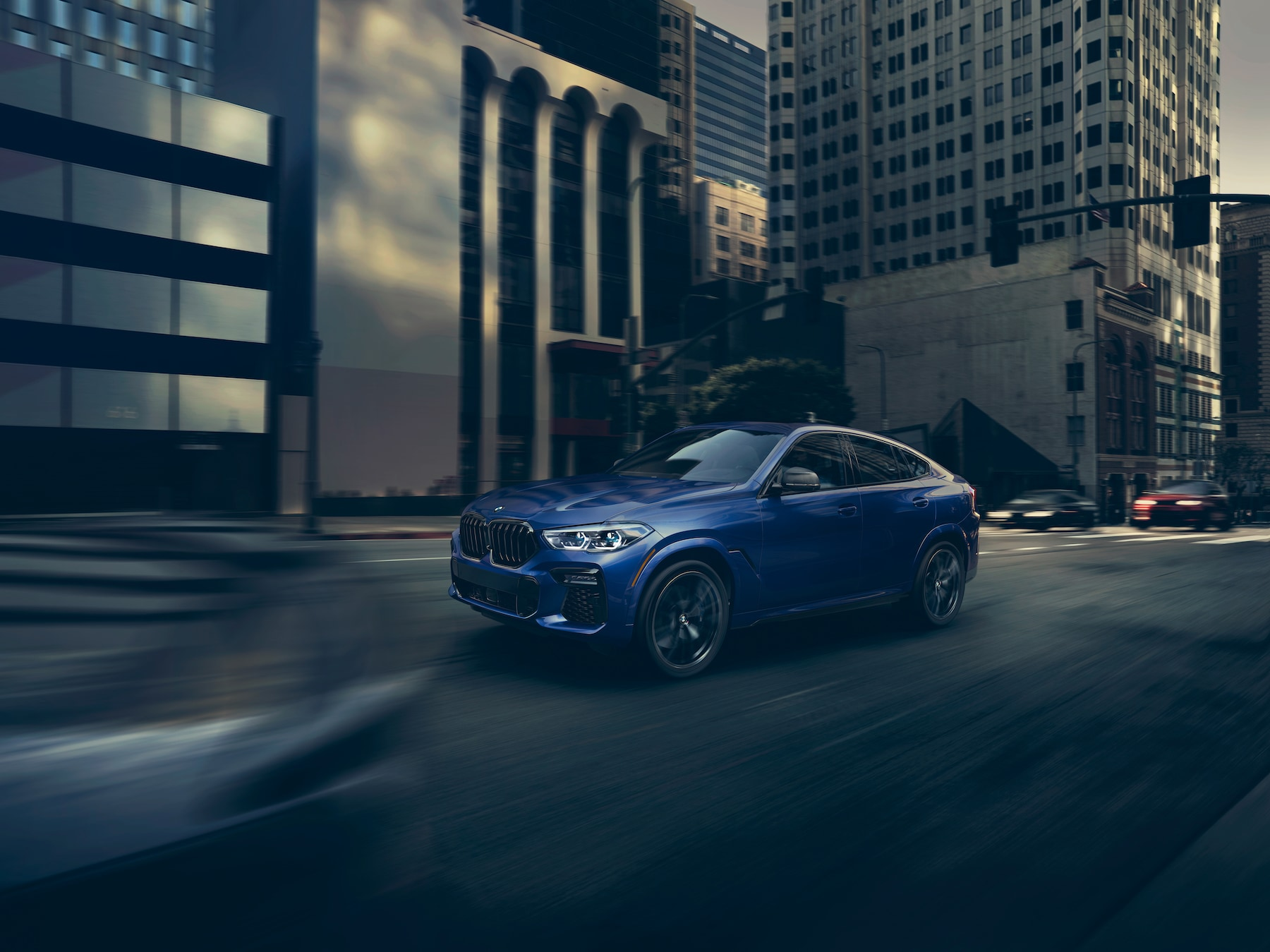 Model features of the 2020 X7 at BMW of Rockville | Blue 2020 BMW X6 running on road