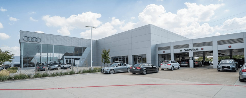 Exterior view of Audi Plano's service center entrance