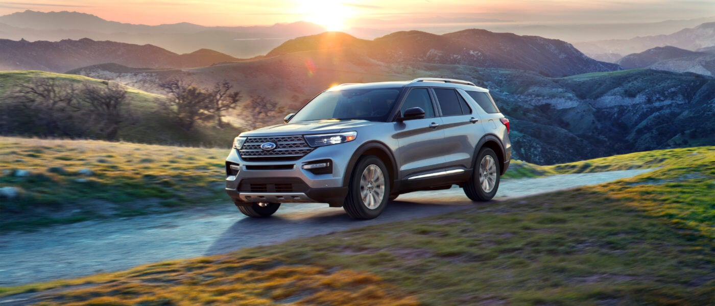A silver Ford Explorer driving through the mountains