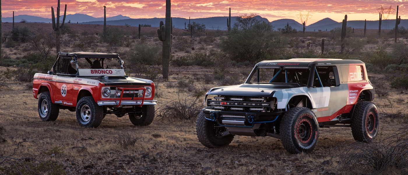 Two old ford Broncos parked in the desert