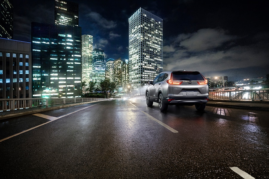 Silver 2018 Honda CR-V city night driving
