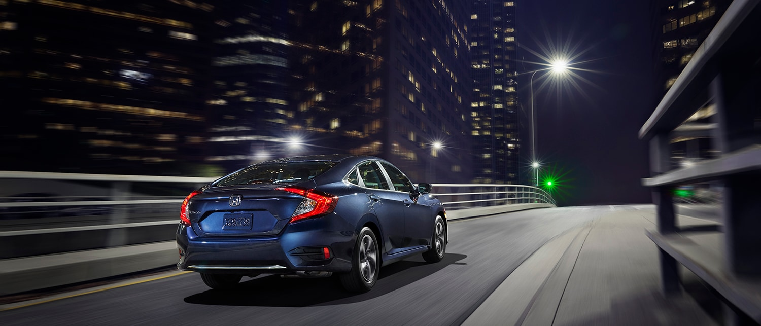 blue civic sedan from behind at night