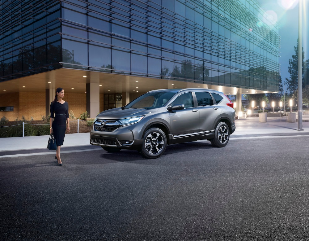 2020 Honda CR-V and CR-V Hybrid features at Bobby Rahal Honda of State College | Woman standing infront of the 2020 Honda CR-V