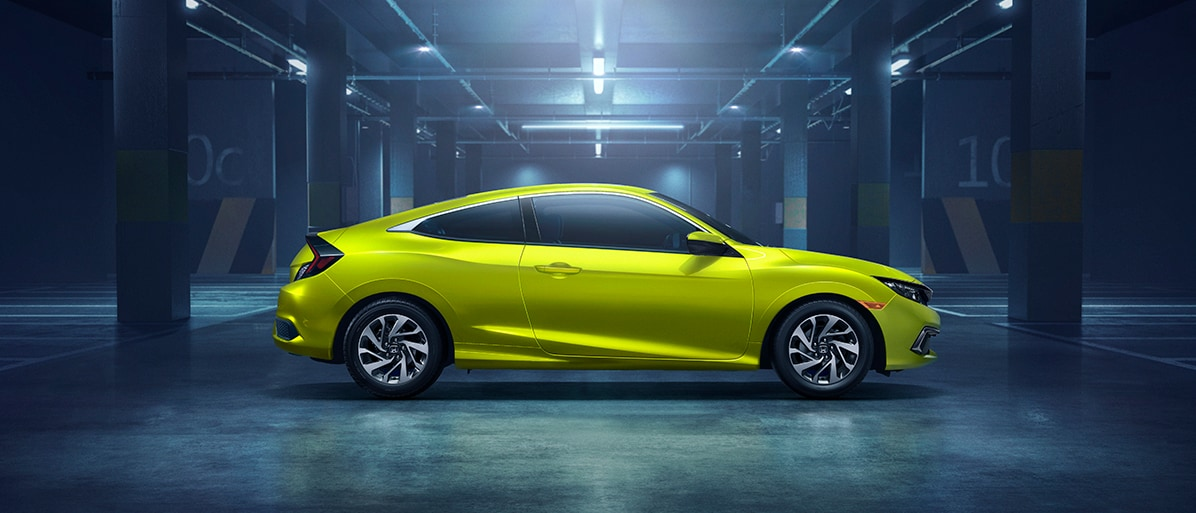 profile of a green civic coupe parked in a garage