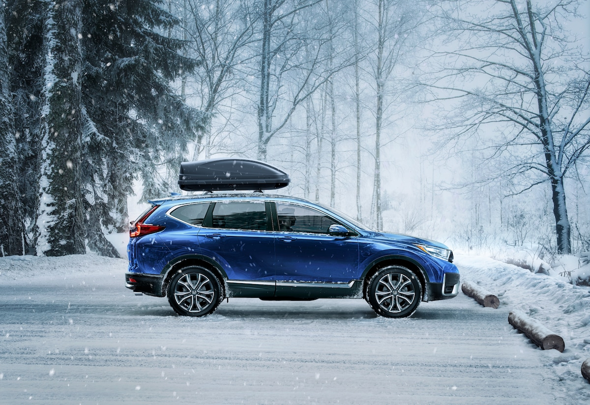 2020 Honda CR-V and CR-V Hybrid features at Bobby Rahal Honda of State College | Blue 2020 Honda CR-V parked on snow