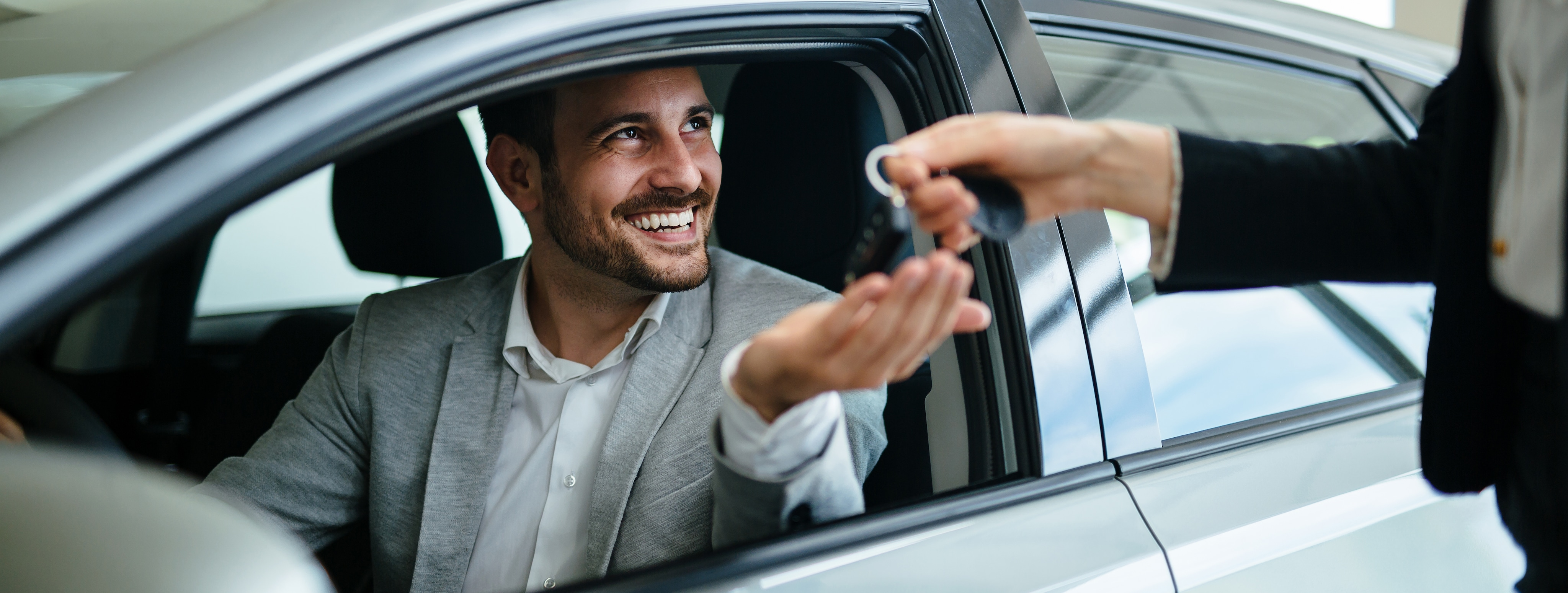 When to Trade in Your Vehicle | Bobby Rahal Lexus of Lewistown | Man holding car key